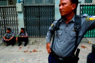 Police officers guard a Muslim residential area in Mandalay