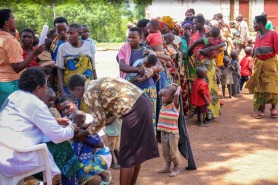 Mothers line up to register their children in Rwanda after fleeing their native Burundi. Photo credit: UNHCR/S. Masengesho