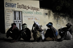 Suspected al Shabab militants wait to be taken off for interogation during a joint night operation between the Somali security services and AMISOM forces in Mogadishu, Somalia. Photo Credit: AU UN IST PHOTO / Tobin Jones
