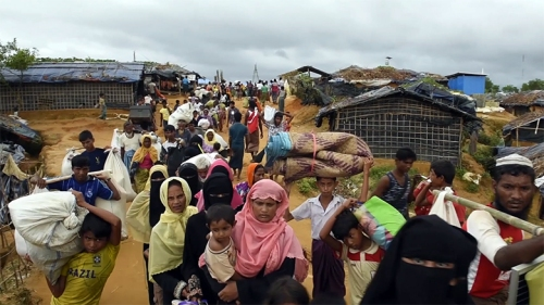 Rohingya  refugees  exhausted  streaming  off  boats  arriving